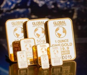Gold hits over five-year high as Fed hints at rate cuts